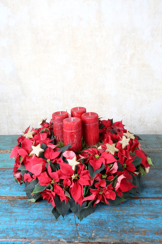 Red poinsettia table arrangement