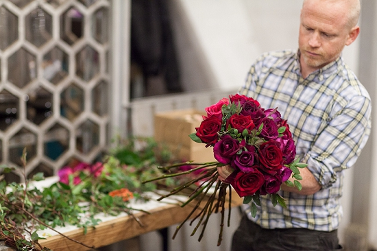 Duncan McCabe of McQueen's preparing designs for British Flowers Week 2014 at New Covent Garden Flower Market