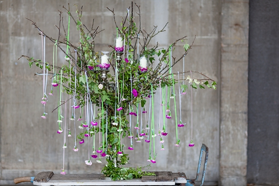 Simon Lycett's design using the British garden pinks in a cascading candelabra for British Flowers Week 2014 at New Covent Garden Flower Market