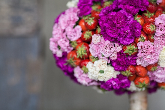 Simon Lycett's design using the British garden pink in a table centre with strawberries for British Flowers Week 2014 at New Covent Garden Flower Market