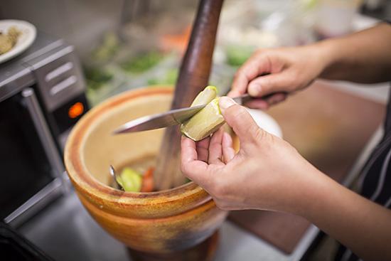 Preparing a green papaya salad