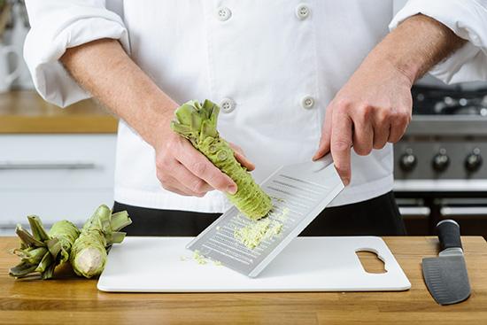 Chef grating wasabi