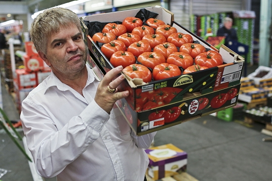 Vasco Soares with Tomatoes at New Covent Garden Fruit and Vegetable Market - August 2014