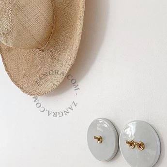 Interrupteur a bascule porcelaine 010 blanc laiton o10cm zangra normal