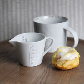 Fine Porcelain Jug With Embossed 'Do Small Things ...'