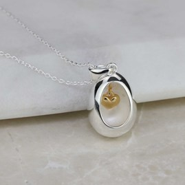 Oval Pendant With Miniature Hanging Heart Silver