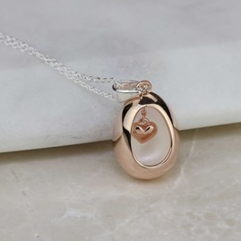 Oval Pendant With Miniature Hanging Heart Rose Gold