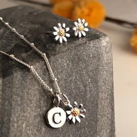 Solid Silver And Gold Petite Daisy Earrings