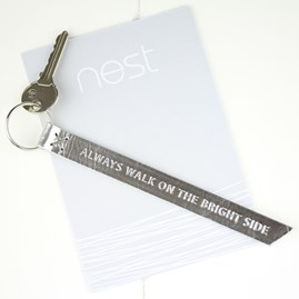 'Always Walk On The Bright Side' Leather Keyring