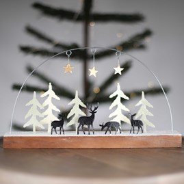 Reindeer And Alpine Winter Scene With Snow And Stars
