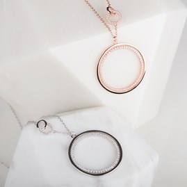 Revolving Circle Pendant With Sparkling Detail