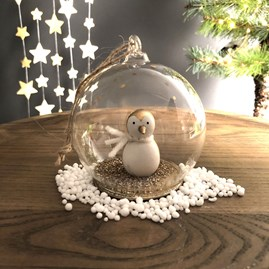 Golden Penguin In A Snow Globe