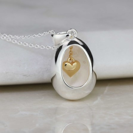 Oval Pendant With Miniature Hanging Heart