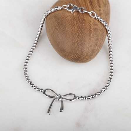 Solid Silver Bow And Bead Bracelet
