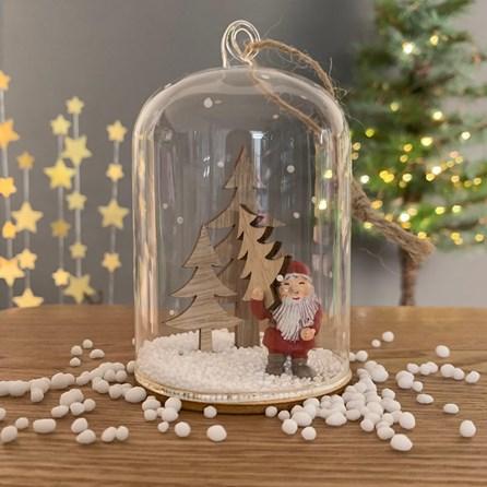 Santa Holding Tree Snow Globe