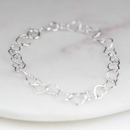 Child's Bracelet With Interlocking Silver Hearts