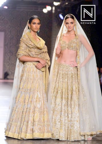 An off-white lehenga with heavy embellishments would make your wedding outfit stand out