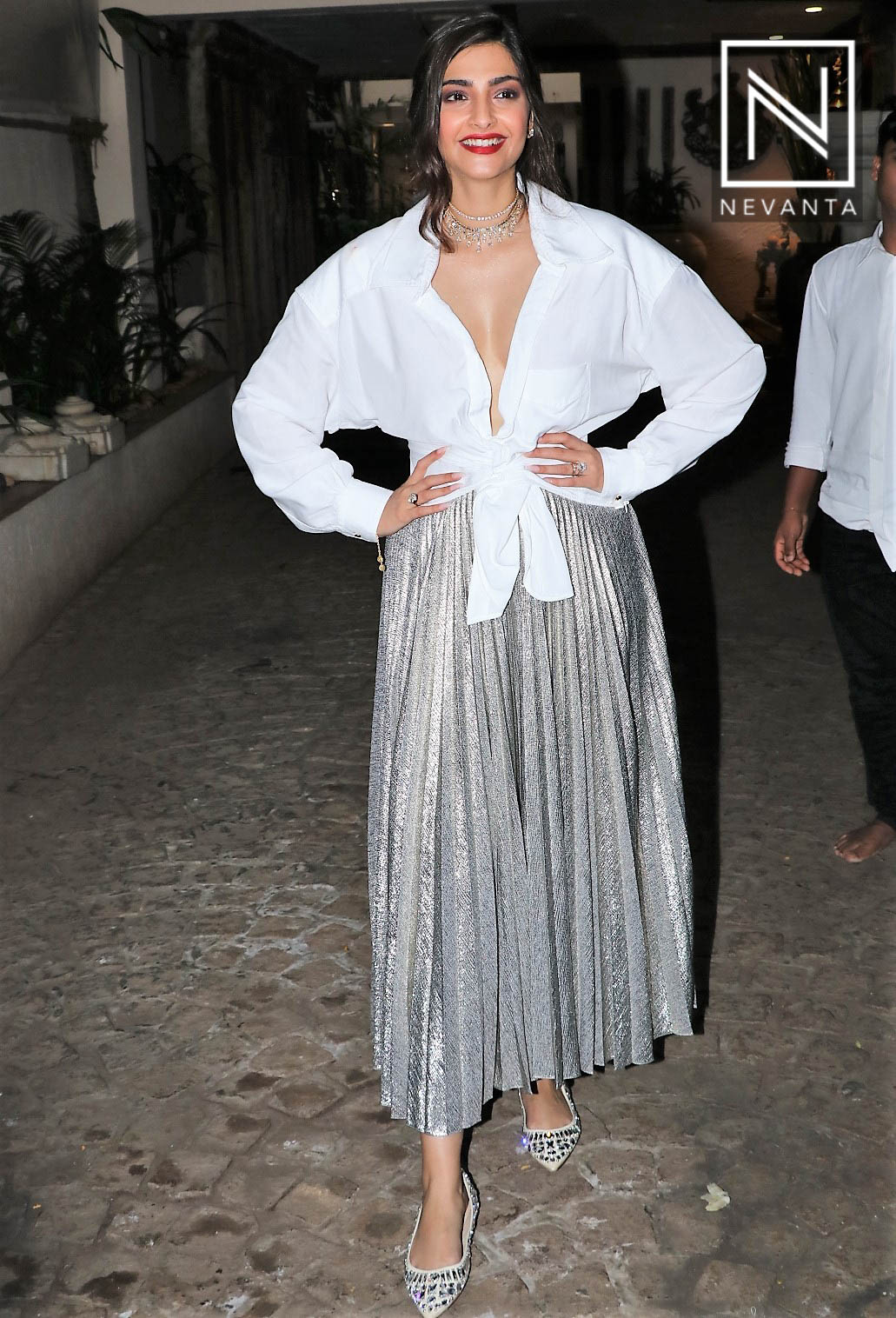 b9cb01657 Sonam Kapoor looked all pretty in a white knotted top from Jacquemus teamed  with a metallic pleated skirt from Emilia Wickstead at her birthday bash -  ...