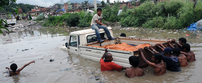 A Nepalese driver and a passenger are he