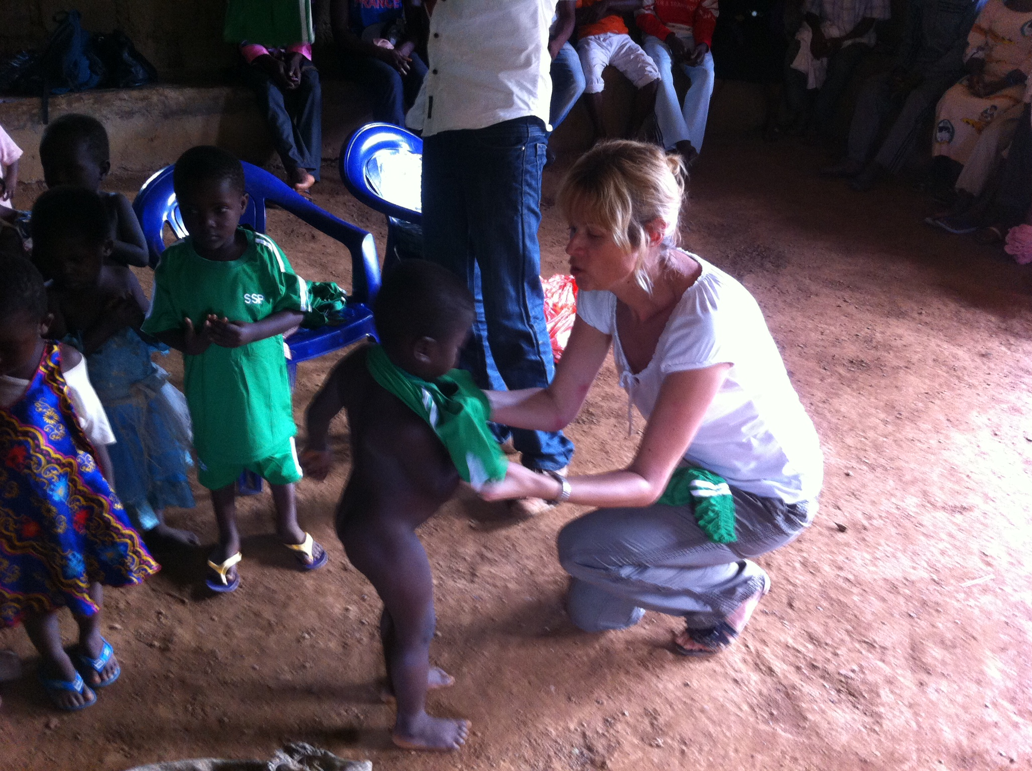 Nicky giving children their new systems