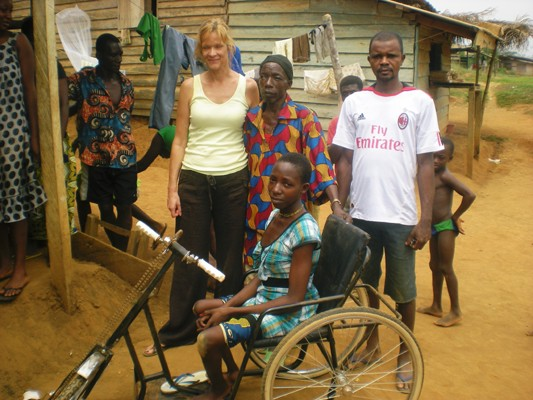 Lilian and her father demonstrating the adapted tricycle