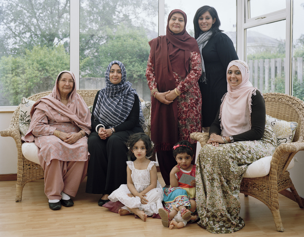 Farkhanda Chaudhry MBE (standing wearing headscarf) with the Women of her Family, Glasgow, 15 May 2011. From A Scottish Family Portrait series