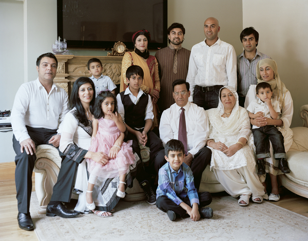 Amar Latif (standing in white shirt) with his Family, Glasgow, 18 June 2011. From A Scottish Family Portrait series