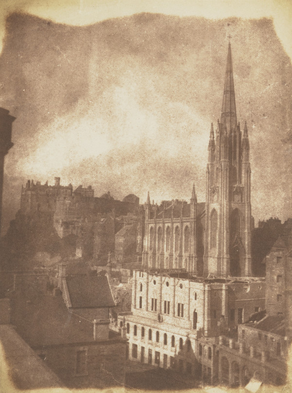 The General Assembly Hall of the Free Church of Scotland during building with the castle and the church of Tolbooth St John in the background ...