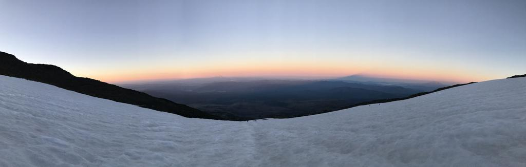 The sunrise colors with Mt Hood on the horizon and a the shadow of Mt Adams cast onto the morning sunlight rays