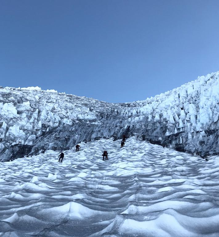 The team approaching the second step of the Kautz glacier