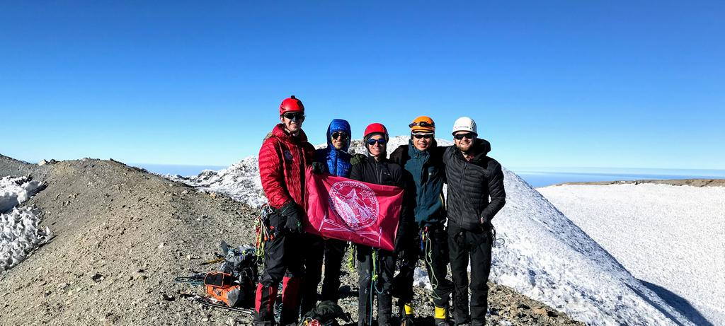 The team at the summit - holding the HMC flag