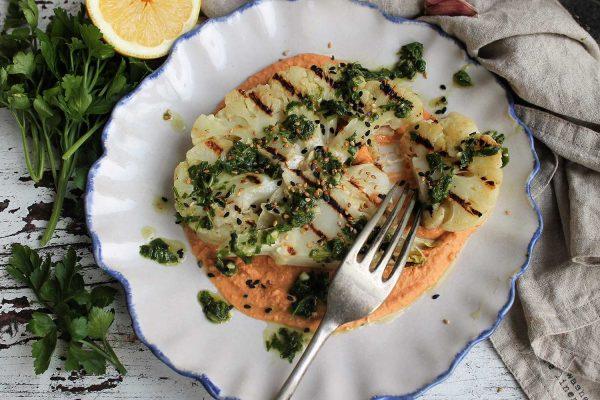 Cauliflower steaks with harissa hummus and chimichurri dressing