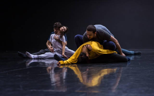Production photo for Grand Finale, four people dancing on stage.