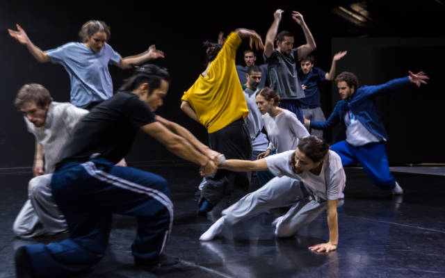 Production photo for Grand Finale, eleven people dancing on stage.