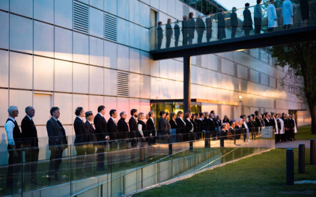 Photo from NNF15 show The Observatory, a long single-file line of people runs down past the Sainsbury Centre for Visual Arts.