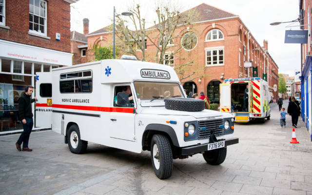 Photo from NNF13 show The Kindness of Strangers, two ambulances parked outside Norwich Playhouse.