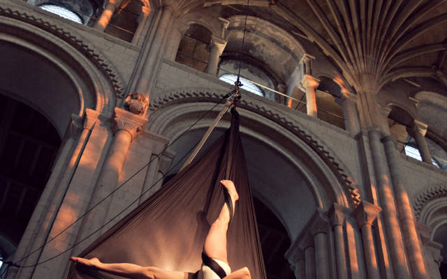 Photo from NNF12 show How Like An Angel, a circus performer hangs from some silk in the Norwich Cathedral.