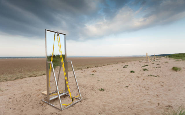 A large free standing mirror on Holkham Beach.