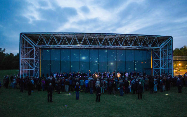 Picture of NNF15 show 'The Observatory', the crowd watch The Voice Project Choir singing.