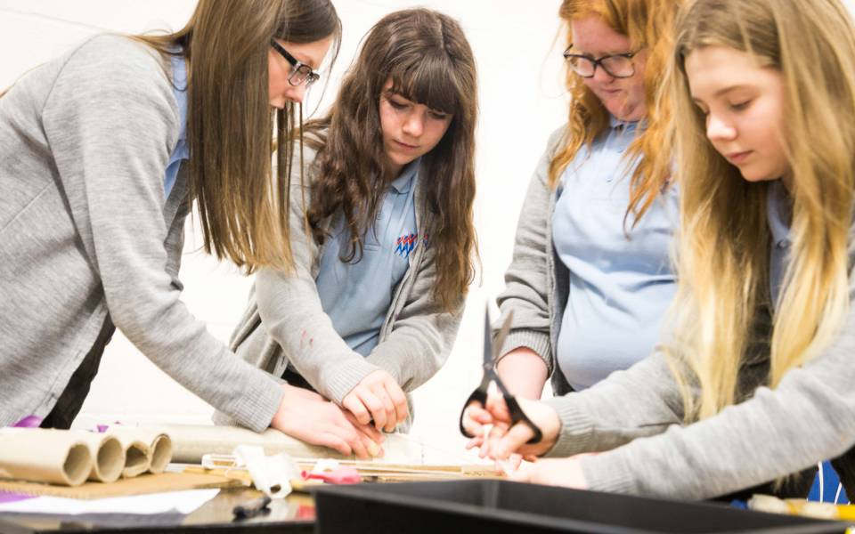 Four female students take part in an NNF workshop.