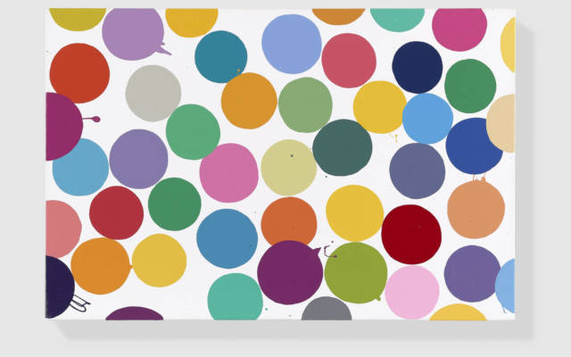 Photo of Damien Hirst painting which is of lots of multicoloured dots.
