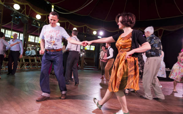 Two people dancing in The Adnams Spiegeltent.