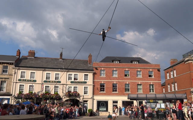 Chris Bullzini tight-rope walks across a town centre