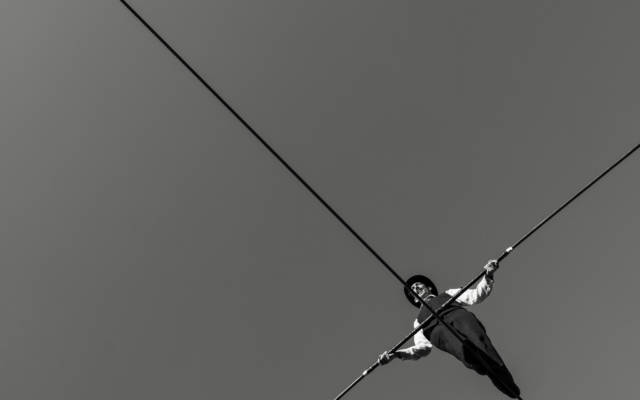 Black and white image of a man on a high-wire