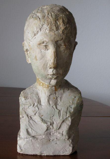 Tête d'un enfant, sculpture de Jean Osouf
