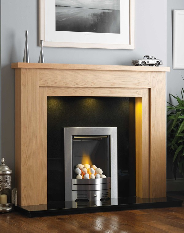 Newark Fire Surround is shown here in Clear Oak