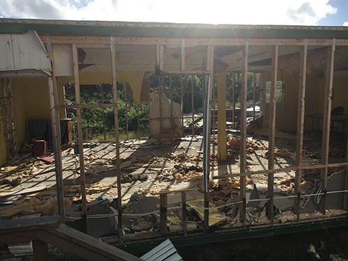 Ayesha volunteers - damaged building