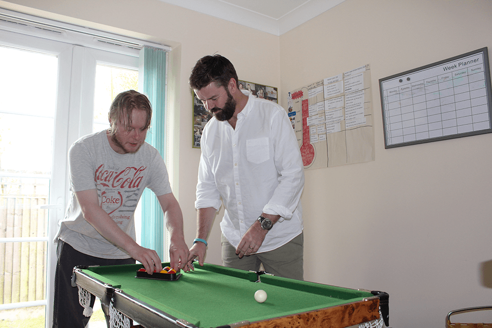Andrew Cannon with Josh playing pool