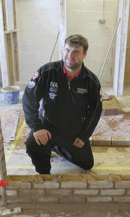 Sean on his brick laying course