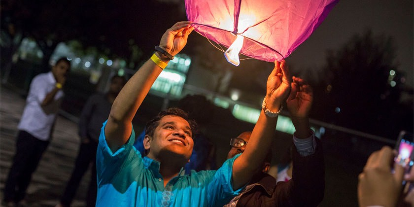 Lighting Lanterns at Diwali Celebrations